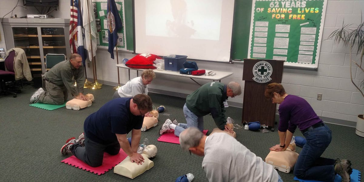cpr class practicing on dummies